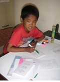 Dilip is now home and back to reading and drawing again