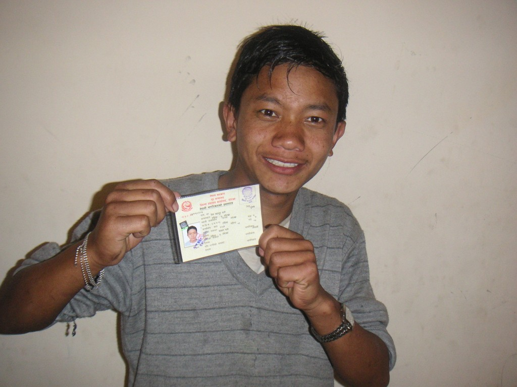 Jack holds up his citizenship card