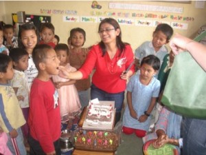 Pramila sharing her birthday with all the children