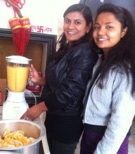 Pramila and Bhagvati make fresh fruit juice for the children