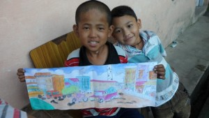 Dilip and Raoul showing their artwork